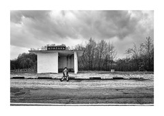 Bus station (Paphylo) Tags: leicaq landscape reallife grain rural indoor countryside contrast leica monochrome busstation loneliness outdoor blackandwhite volyn ukraine village countrylife document