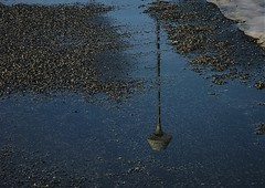 streetlight in a puddle (EllaH52) Tags: water puddle thaw ice sky blue streetlight lamppost gravel spring sunlight sun