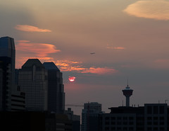fly me to the sun (Cloud Cave) Tags: sky jet plane city calgary tower sunrise clouds urban architecture shadows