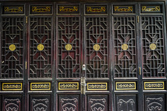 Traditional Chinese style wooden door (phuong.sg@gmail.com) Tags: gateway ancient architecture asia asian background brown building china chinese classic decor decoration design door entrance exterior frame front furniture gate grid handicraft hardwood historical history home house ming old oriental ornament ornamental outdoor outside plank structure style temple texture traditional vintage wall wood wooden