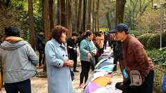 Negotiations at the Marriage Market - People's Park, Shanghai (Joshua Khaw) Tags: marriage market shanghai china peoples park people talking negotiation parents street