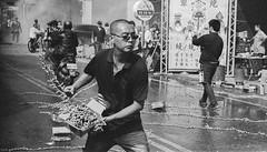 throwing firecrackers (steve: they can't all be zingers!!! (primus)) Tags: canonae1p canonfd50mmf14 chromenose kodaktrix400tx canon primelens prime primecanonlens film filmcamera kodakfilm taiwan taichungtaiwan taichung longjing longjingdistrict