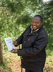 Kieni farmer Paul Mugo Waithaka is very happy to get a bag of his own coffee (Coffee Collective) Tags: kenya kieni coffee directtrade nyeri thecoffeecollective
