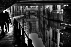 Manchester (Missy Jussy) Tags: manchester city citylife canal shadows light reflections bridge people mono monochrome blackwhite bw blackandwhite buildings railings walkways path setts water 50mm ef50mmf18ll ef50mm canon50mm fantastic50mm canoneos5dmarkii canon5d canon5dmarkll canon outdoor outside northwest england