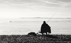Face. (Canad Adry) Tags: porst fujinon umc xm g 50mm f12 beach people man fishing sky black white monochrome bw south sun winter light shadow contrast sit horizon vintage old classic legacy prime manual german fujica lens