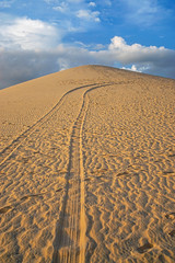 Wheel Tracks in the Sand leading to the Peak of the Mountain in Mui Ne, Vietnam