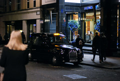 The black cab (D E L I C A T E - L E N S) Tags: nikon d80 lens fixed focal length 50mm snapshot nigth photography london uk black cab taxi hotel cinematic low light streets street