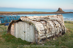 Herring boat shed on Holy Island Northumberland (john@johnrobertsimages.co.uk) Tags: grass hut landscape seashore water cabin outdoor sea beach ocean herring shed hovel sky boat coast shelter shack shanty rural shore holy 3x2 travel outbuilding northumberland hutch island building countryside outdoors daylight watercraft vessel