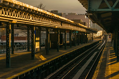 19-150 (George Hamlin) Tags: new york city transit authoity railroad passenger train subway elevated astoria boulevard station queens light shadow dark glint tracks sky steel structure lattice photo decor george hamlin photography