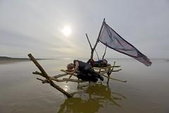 The wanting comes in waves (pauldunn52) Tags: beach art boat driftwood paul sun