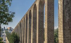 remedios aqueduct (ikarusmedia) Tags: colonial arcs architecture aque aqueduct remedios tower cars avenue blue sky pines trees nauc naucalpan state mexico