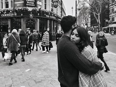 Feeling a bit meh (Rob Pearson-Wright) Tags: streetphotography street candid bw blackandwhite soho hug love england uk london woman man shotoniphone mobilephotography iphone7plus iphone iphoneography