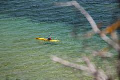 Solitude (Greenstone Girl) Tags: australia frankston beach sand portphillipbay pier water people sky blue gulls yellowcanoe headland polarising lens