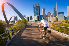 A man cycling on an elizabeth bridge in Perth city (anekphoto) Tags: perth australia city western quay skyline elizabeth bridge modern travel urban river view cityscape downtown outdoor bike sport building landmark tower arch waterfront summer capital centre people construction central sunset man cycling bicycle biking healthy road lifestyle ride biker activity cycle bicyclist helmet rider person outdoors relax health relaxation recreation