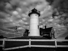 Le Phare / The Lighthouse (CTfoto2013) Tags: nb bn bw blancoynegro noiretblanc blancetnoir lande path chemin barriere fence arbres trees fields champs ciel sky clouds nuages lumiere light champetre rural bucolique lighthouse phare falmouth woodshole massachusetts monochrome outdoor moor house maison armosphere mood cloudy nuageux architecture building immeuble landscape seascape paysage nobskapointlight capecod lumix gx7 panasonic stormy orageux storm orage ambiance tower retro vintage blackandwhite