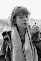 Smoking (piotr_szymanek) Tags: woman young face portrait blackandwhite eyesoncamera smoking outdoor piercing lipspiercing nosepiercing eyebrowpiercing michalina 1k 20f 5k 50f 10k 20k