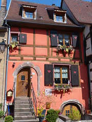 Hearts and Easter Eggs (Marit Buelens) Tags: france frankreich frankrijk alsace elzas elsass kaiserberg building halftimbered colombages vakwerkhuis huis maison haus house red rood rouge decoration easter pasen heart shutters egg paasei steps door kaysersberg