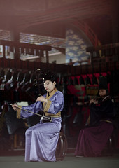 Woman Playing Traditional Chinese Stringed Instrument, Beijing, China (Eric Lafforgue) Tags: mg0646 adult adultsonly ancienttimes art asia beijing china chineseculture colorpicture costume culture maturemen music musician onewomanonly outdoor pekin play playing realpeople theatre tradition travel twopeople twopersons vertical women