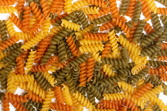 Colorful raw uncooked macaroni background (wuestenigel) Tags: dry color mediterranean background dinner red carbohydrate uncooked italian cook pile meal yellow white raw market whole closeup cooking focus macaroni healthy diet studio gourmet food fusilli ingredient wheat cuisine heap lunch macro green fresh tasty pasta staple