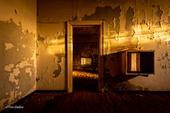 Waiting (Tim-Dallos) Tags: africa namibia desert deserted diamond mining ghost town d750 ruined haunted crumbling shadows light paint peeling rays eerie 1930s nikon sun sand doorway