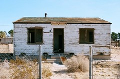 This lone wolf can survive in this lonely town (Zach Bradley Photography) Tags: abandoned 35mm ghostsinlove zachbradley leo film filmphotography mojavedesert indie emophotography rural explore nikon vintage places yermocalifornia barstowcalifornia california ghosts haunted analog