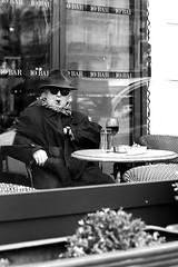 Behind sunglasses (pascalcolin1) Tags: paris homme man café table cigare cigar reflets reflection vitre windows vin wine verre glass photoderue streetview urbanarte noiretblanc blackandwhite photopascalcolin 5omm canon50mm canon