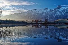 Mountainside sunrise (Tjaldur66) Tags: lake lakeshore reflection morning morninglight sunrise winter winterlandscape peaks snowypeaks switzerland outdoor bluehour swissmountains swissalps mountains