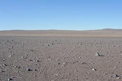 Desert Ground (Chris Hunkeler) Tags: chile atacama desert flat rocky drivable surface dry barren