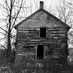 MN CR16: Rural Winter Study #7 (strollingshuttereyes) Tags: farmhouse rustic weathered abandoned woodgrain worn wood sony architecture travel canoncamera rural house country trees sky building derelict window windows winter snow minnesota lanesboro
