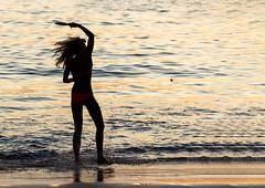 Silhouette of girl playing ball. Phuket island, Thailand XOKA9905bs