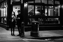 Checking (Sean Batten) Tags: london england uk europe bricklane shoreditch eastlondon city urban streetphotography street blackandwhite bw candid people man woman drinking coffee fuji x100f fujifilm texting