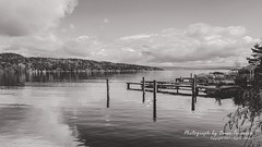 Maybe We May (oterrason) Tags: landscape beautiful bw blackandwhite home house jetty dock boat boatlift sky clouds cloudscape mountains hills water lake pacificnorthwest seattle washington view scene scenic