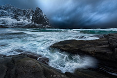 Norge - Rolling in (Ron Jansen - EyeSeeLight Photography) Tags: lofoten norway beach cliff steep mountain sea storm clouds wind waves water aggressive mood blue dynamic landscape seascape