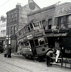 London transport E1 tram 576 accident Woolwich New road 18/04/1946. (Ledlon89) Tags: tram tramway tramcar trams accident london transport electrictransport lt lte lptb londontransport woolwich southeastlondon shops crash tracks rails 1946