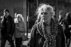 Looking Back (Leanne Boulton) Tags: urban street candid portrait portraiture streetphotography candidstreetphotography candidportrait streetportrait streetlife old elderly woman female face eyes expression mood emotion feeling sunlight backlit atmosphere hair wind windy weather tone texture detail depthoffield bokeh naturallight outdoor light shade shadow city scene human life living humanity society culture lifestyle people canon canon5dmkiii 70mm ef2470mmf28liiusm black white blackwhite bw mono blackandwhite monochrome glasgow scotland uk
