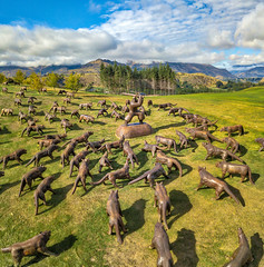 Attack of the Wolves at the Hills (Trey Ratcliff) Tags: drone newzealand queenstown stuckincustomscom treyratcliff tutorial wolves art sculpture golfcourse golf hills remarkables samurai grass green clouds blue sky dji quadcopter hdr hdrtutorial hdrphotography hdrphoto aurorahdr