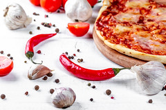 Pizza with garlic, pepper, chili and tomatoes on the table (wuestenigel) Tags: nutrient lay composition garlic sauce recipe pepper table eat background dinner delicious pizza homemade cooked meal cheese organic vegetable flat tomato wooden grey traditional view italian chili bacon meat tasty slice food nutrition healthy ingredient cherry cuisine top space black gourmet fresh spices white appetizing