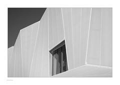 Man in the Box (Michael Fleischer) Tags: shoppingcenter city facade window man frame lines architecture sky blackwhite monochrome sunshine shadow guard
