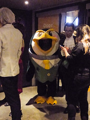 Doorman or Duckman (Steve Taylor (Photography)) Tags: duck waistcoat tie cartoon black grey yellow fun smiling addington armageddonexpo armaggedon costume outfit penguin