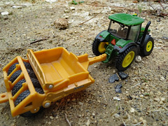 ERTL Scraper And Tractor. (dccradio) Tags: lumberton nc northcarolina robesoncounty outdoor outdoors outside diecast toy toys scraper tractor ertl johndeere deere 7280r dirtstones pebbles rocks constructionequipment ag agriculture agricultural farm farming canon powershot elph 520hs