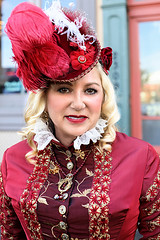 Pretty In Shades Of Red (wyojones) Tags: texas galveston dickensonthestrand holidayfestival hat dress blond hair girl lady lovely woman beautiful beauty feathers smile pretty curls lace red