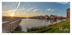 Shoot the Sun (Bob Geilings) Tags: sun sunset bluesky water grass bridge houses shootthesun nieuwvennep netherlands