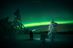Night Watch (janiylinampa) Tags: aurora borealis auroraborealis northernlights nordlich norrsken polarlicht revontulet nightphotography night stars man trees light green blue snow phenomenon lapland finland lappi suomi laponie laponia lappland finnland auroras