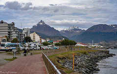 The waterfront in Ushuaia / Набережная в Ушуайе (Vladimir Zhdanov) Tags: travel argentina tierradelfuego ushuaia city architecture building ocean sky cloud water mountains snow car people