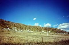 All Over the Hill (hiphopmilk) Tags: copyright©jaredyehwooehmoehfilms konica offroad 現場監督 zoom 35mm 135film film analog analogue jaredyeh hiphopmilk kodak travel china sichuan aba hongyuan qiongxi qiongxizhen tibetan longrang prayerflags hill hillside sky cloud