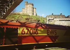 Train and Tower, Edinburgh, April 2016 (Mano Green) Tags: train tower sky shadow light edinburgh scotland uk april 2016 spring history lomo lca kodak gold 200 35mm film rail