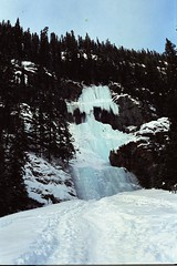 The Ice Climber 2 (pmvarsa) Tags: winter 2002 analog film 135 cans2s kodak royal gold 200iso kodakroyalgold200 royal2002 nikonsupercoolscan9000ed nikon coolscan cold snow ice frozen rocky moutains mountain national park trees forest water waterfall falls sport activity outdoor climbing person climber nature canon ftb canonftb classic camera banff lakelouise alberta canada ab