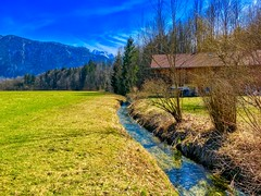 Brook, field and trees in spring near Kiefersfelden, Bavaria, Germany (UweBKK (α 77 on )) Tags: brook creek stream water flow reflection green field tree trees forest farm mountain spring blue sky kiefersfelden bavaria bayern germany deutschland europe europa iphone