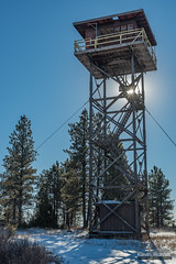 Yager Butte Fire Lookout (kevin-palmer) Tags: custernationalforest ashland montana december winter snow sunny blue sky nikond750 tamron2470mmf28 yagerbutte firelookouttower old abandoned tall structure hills afternoon pine trees sun sunstar stairs deck railing red