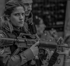 What do you want from me? I am just doing my duty (ybiberman) Tags: israel jerusalem oldcity alquds muslimquarter damascusgate woman maiden people soldier borderpolice worry m16 gun rifle pistol uniform candid streetphotography troubled bothered